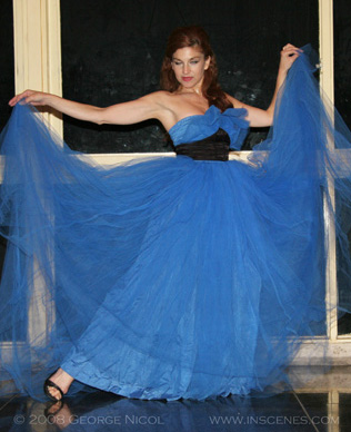 photo of a woman in long blue dress