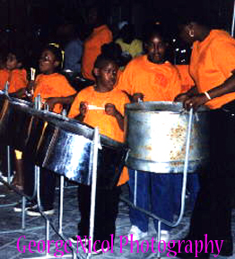 photo of children playing drums