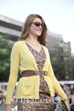 photo of a woman in brown dress and yellow cardigan