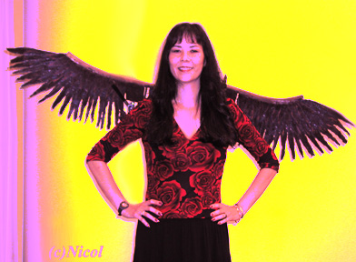 picture of a woman with wings on yellow background