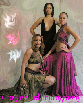 photo of three women in black, pink, and green dresses