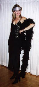 photo of a woman in a black dress and black feather boa