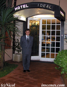 photo of a hotel entrance with a guard