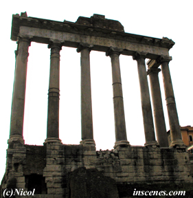 photo of antique temple structure with columns