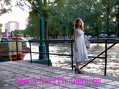 photo of a woman on a river pier