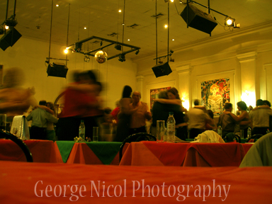 photo of dancing couples in a restaurant